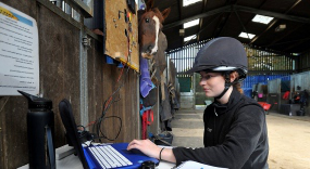 Student working in stables at Fosshill